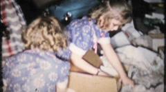 300 - girls get dolls for Christmas - vintage film home movie Stock Footage