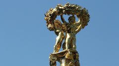 Germany Berlin Tiergarten golden cherub sculpture atop monument Stock Footage