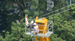 4k UHD video of two workers working on a construction tower crane Stock Footage