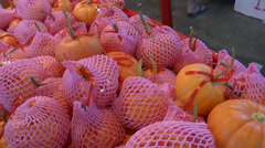 Small pumpkins on sale during Chinese New Year (MANDRAIN ORANGE--1a) Stock Footage