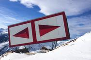 Stock Photo of red navigation sign in the alps