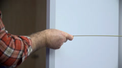 Measuring the distances and lengths in the room Stock Footage