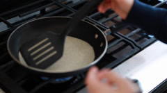 Cooking a tortilla in a pan Stock Footage
