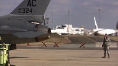 F-16 Fighting Falcon ground crew talking to pilot Stock Footage