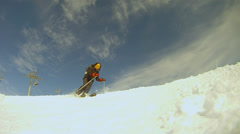 Slow motion of a skier skiing down the slope Stock Footage