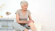 Stock Video Footage of Injured patient rubbing her painful knee