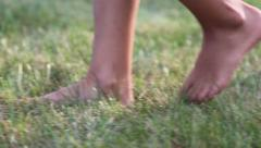 Child walking barefoot Stock Footage
