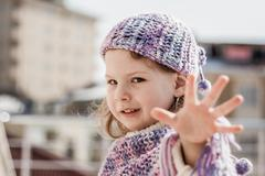Purple beret girl shows her fingers Stock Photos