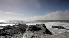 Ocean waves and fields view - stock footage