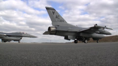 Low down view of an F-16 Fighting Falcon jet fighter taxing Stock Footage
