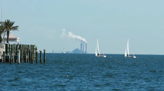 Sailboats against an industrial background Stock Footage