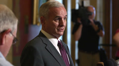 Minnesota Governor Mark Dayton in a press conference - stock footage