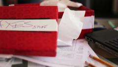 Left rotation slider shot workplace doing taxes open shoe box receipts form 1040 - stock footage