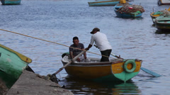 Men rowing on a boat in Alexandria, Egypt - stock footage