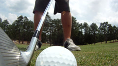 Close-up wide-angle view of golf ball being hit Stock Footage