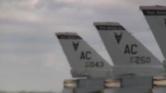 Flightline of F-16 Fighting Falcon jet fighters preparing for mission Stock Footage