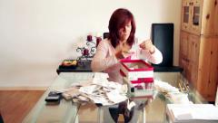Tax time - woman organizes receipts out of shoe box - stock footage