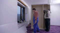 Males putting the wardrobe together Stock Footage