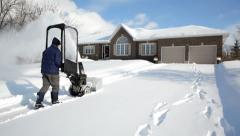 Man Using A Gas Snow Blower Stock Footage
