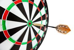 Bulls eye target with dart Stock Photos