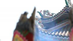 Huge joss stick,focus pulled Chinese house background. - stock footage