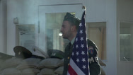 Stock Video Footage of 149 Berlin, Checkpoint Charlie, guard with american flag