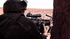 Marines setting up a support position with rifle Stock Footage