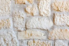 Wall lined with porphyry stones Stock Photos