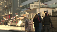 Stock Video Footage of 154 Berlin, Checkpoint Charlie, cars passing by