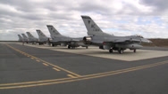 Stock Video Footage of Six F-16 Fighting Falcon jet fighters preparing to taxi out to the runway