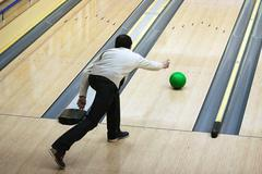 green sphere sliding on a path in bowling - stock photo