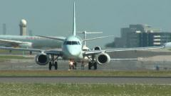 Stock Video Footage of Taxiing Airplanes heading for the Runway