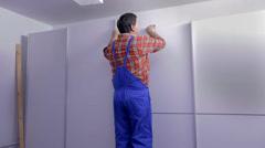 Man polishing the edge of the wardrobes Stock Footage