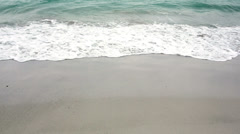 Ocean rolling in over the beach - stock footage