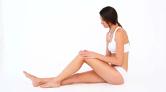 Fit woman touching her sore knee and shaking her head Stock Footage