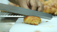 Stock Video Footage of croissant cutting.