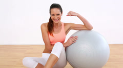 Fit model flexing her bicep and smiling at camera Stock Footage