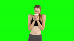 Fit model drinking from disposable cup Stock Footage