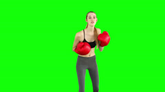 Fit model punching with red boxing gloves Stock Footage