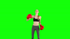 Fit model cheering with red boxing gloves Stock Footage