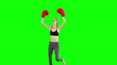 Slim model cheering with red boxing gloves Stock Footage