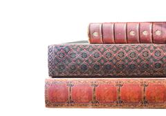 stack of old leatherbound books isolated on white - stock photo