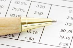 Pen on the financial spreadsheet Stock Photos