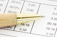Stock Photo of pen on the financial spreadsheet