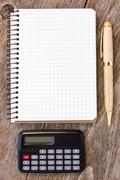 notebook, pen and calculator - stock photo
