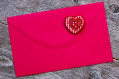 Stock Photo of red paper envelope with decorative heart