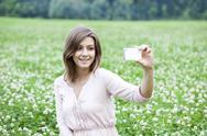 Stock Photo of young woman taking pictures on your phone