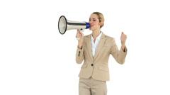 Positive businesswoman shouting through megaphone Stock Footage