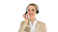 Smiling call centre agent talking on the headset - stock footage