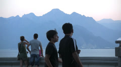 Turkey Antalya tourists w Taurus Mountains beyond Stock Footage